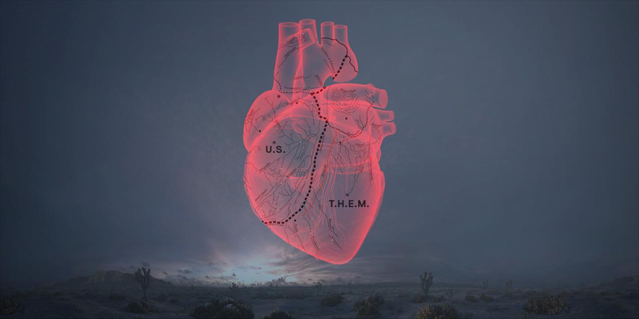 """O desenho de coração, dividido entre """"us"""" (nós) e """"them"""" (eles) está no pôster do filme e no vestíbulo da instalação em que ele é exibido"""