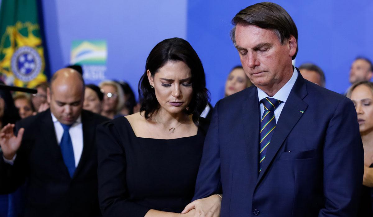 O presidente Jair Bolsonaro e a primeira-dama, Michelle Bolsonaro, durante o Culto de Ação de Graças promovido no Palácio do Planalto em 2019